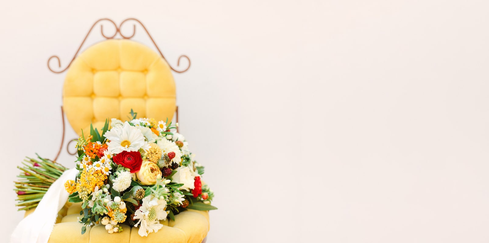 wedding bouquet on a yellow chair